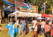 WATERBURY, CT. 30 June 2018-063018BS424 - People line up to get some cold beverages, especially the Pina Coladas, on a very hot day during the Fourth Annual Jerk Festival featuring authentic food from the Caribbean at Library Park in Waterbury, CT on Saturday afternoon. Bill Shettle Republican-American