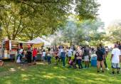WATERBURY, CT. 30 June 2018-063018BS424 - People line up to get some authentic caribbean food during the Fourth Annual Jerk Festival featuring authentic food from the Caribbean at Library Park in Waterbury, CT on Saturday afternoon. Bill Shettle Republican-American