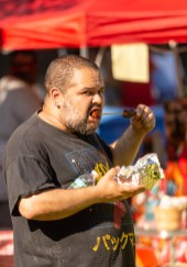 WATERBURY, CT. 30 June 2018-063018BS424 - Jose Orellana of Waterbury enjoys a chicken skewer during the Fourth Annual Jerk Festival featuring authentic food from the Caribbean at Library Park in Waterbury, CT on Saturday afternoon. Bill Shettle Republican-American