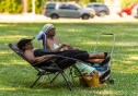 WATERBURY, CT. 30 June 2018-063018BS424 - Deborah Pierce of Waterbury, left, and Joan McLaren of Southington take it easy relaxing during the Fourth Annual Jerk Festival featuring authentic food from the Caribbean at Library Park in Waterbury, CT on Saturday afternoon. Bill Shettle Republican-American