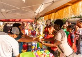 WATERBURY, CT. 30 June 2018-063018BS424 - Lisa Fletcher visiting from Jamaica, right, gets a nice cold Pina Colada to quench her thirst on a very hot day during the Fourth Annual Jerk Festival featuring authentic food from the Caribbean at Library Park in Waterbury, CT on Saturday afternoon. Bill Shettle Republican-American