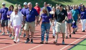 "SOUTHBURY, CT-070818JS13-- Family, friends and supporters make their way around the track during Sunday's ""Walk for Wade"" event held at Pomperaug High School in Southbury. Wade Prajer, a star athlete at Pomperaug and a criminal justice major at University of New Haven, took his own life on June 3 at the age of 22. The walk was held to honor his life and to help prevent future tragedies. Proceeds from the event will benefit the Alex Archie Foundation. Jim Shannon Republican American"