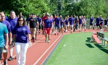 "SOUTHBURY, CT-070818JS14-- Family, friends and supporters make their way around the track during Sunday's ""Walk for Wade"" event held at Pomperaug High School in Southbury. Wade Prajer, a star athlete at Pomperaug and a criminal justice major at University of New Haven, took his own life on June 3 at the age of 22. The walk was held to honor his life and to help prevent future tragedies. Proceeds from the event will benefit the Alex Archie Foundation. Jim Shannon Republican American"