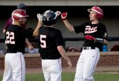 Oakville's Matt McGrath (10), right, is congratulated by teammates Justin Guerrera (22) and Alan Stinson) after coming in to score on a two-RBI hit by Cam Defeo (3) during their Zone 5 American Legion game against Naugatuck Tuesday at the Taft School in Watertown. Jim Shannon Republican American
