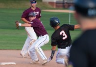 Naugatuck's Corey Plasky (11)throws to first to complete the double-play after getting Oakville's Cam Defeo (3) on a force play at second base during their Zone 5 American Legion game Tuesday at the Taft School in Watertown. Jim Shannon Republican American