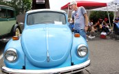 Kevin Bird of Naugatuck checks out a 1971 VW Beetle at the second annual St. Vincent Ferrer Church Car Show in Naugatuck Sunday. Steven Valenti Republican-American