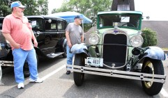 From left, Carol Palomba of Watertown and Tony Durante of Watertown check out a 1930 Model A Ford at the second annual St. Vincent Ferrer Church Car Show in Naugatuck Sunday. Steven Valenti Republican-American