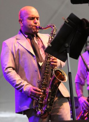 GOSHEN, CT - 6 August 2016 - 080616JM03 - Albert Rivera, leader of the Back at it Band, plays saxophone during the Litchfield Jazz Festival at the Goshen Fairgrounds on Saturday. John McKenna Photo