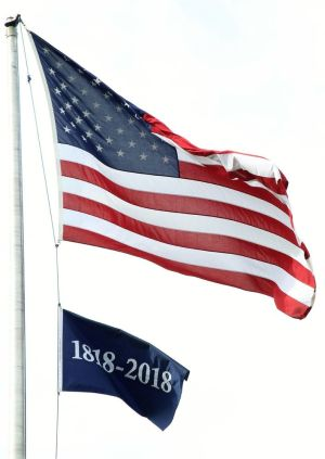 A flag flying on the flagpole on the Litchfield Green notes the 200th anniversary of the Borough of Litchfield. John McKenna Republican-American
