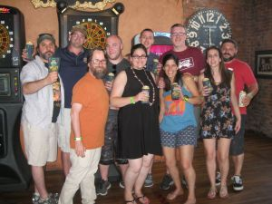 Members of the Two Roads Brewing bar crawl through Torrington enjoy a Road to Ruin and wings at Sawyer's, led by brewery representative Tim Phelps, second from left. - Will Siss Republican-American
