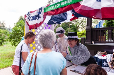 TORRINGTON, CT. 28 July 2018-072818BS12 - Diane Callahan of Wethersfield, a re-enactor of the Women Sufferage of 1918 yells out to people to get involved during the WW I Living History Day at the Torrington Historical Society in Torrington, CT on Saturday afternoon. Bill Shettle Republican-American
