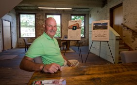 Brian L. Lyman, the managing real estate broker for Parker Benjamin Real Estate Services who is marketing Mad River Lofts, sits inside the model loft at Mad River Lofts in Winsted on Friday.Jim Shannon Republican American