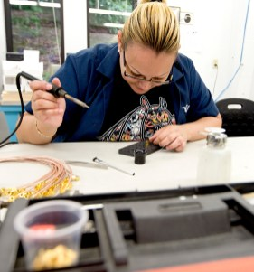 Maria Montalvo of Waterbury, works in the cable assembly area Friday at Palco Connector in Naugatuck, an affiliate of The Phoenix Company of Chicago, Inc., on Friday. Jim Shannon Republican American