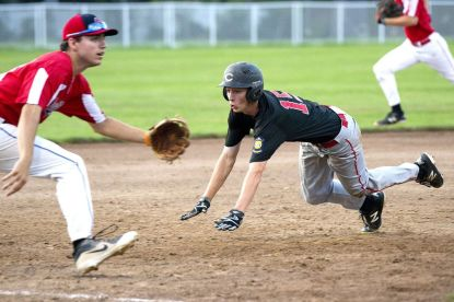 MERIDEN, CT-073118JS10--Cheshire's Ian Battipaglia (18) dives into third base as Southington's Jeremy Mercier (14) had to chase down the throw, during their American Legion tournament game Tuesday at Ceppa Field in Meriden.Jim Shannon Republican American