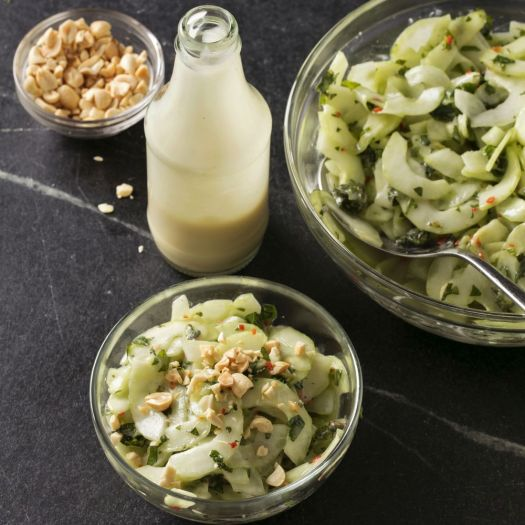 This undated photo provided by America's Test Kitchen in July 2018 shows cucumber salad with creamy roasted garlic dressing in Brookline, Mass. This recipe appears in the cookbook þÄúJust Add Sauce.þÄù (Steve Klise/America's Test Kitchen via AP)