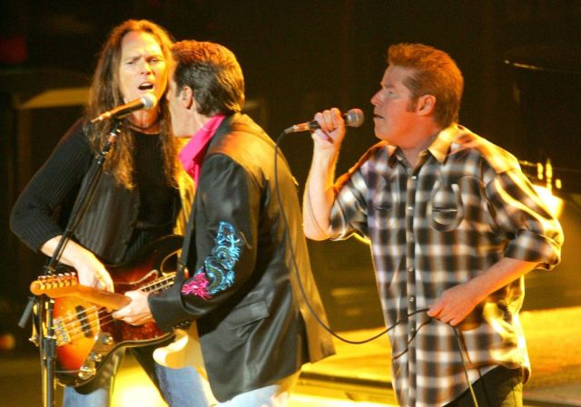 Don Henley, right, Timothy B. Schmit, left, and Glenn Frey of The Eagles perform at Yokohama Arena in Yokohama, west of Tokyo, Tuesday, Oct. 26, 2004. The legendary U.S. rock band was in Japan on their Final 1 world tour. (AP Photo/Shizuo Kambayashi)