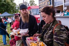 SOUTHBURY, CT. 22 September 2018-092218 - Brett Bennett and his wife Bobbi-lynn of Southbury get their dinner along Food Truck row at the Southbury Celebration on the Southbury Training School Grounds in Southbury on Saturday. Bill Shettle Republican-American