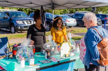 NAUGATUCK, CT. 29 September 2018-092918 - From left Victoria Flores of Naugatuck wearing the Boston Terrier mask and Franchesca Sanchez of Waterbury chat with Anna Bednarczyk of Waterbury, about their business Pawsitive Vibes Grooming during the third annual Ion Bank/Mission 22 Fall Festival on Maple Street and Rubber Avenue in downtown Naugatuck on Saturday. Bill Shettle Republican-American