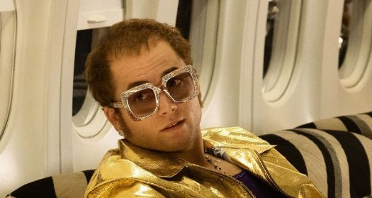 Taron Egerton in character as Elton John for a new biopic about the legendary British rocker that will hit theaters in May. Egerton, of the 'Kingsman' movie franchise, sings the rocker's classic songs. (Paramount)