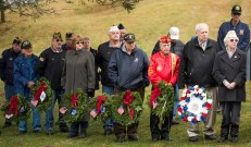 WATERTOWN, CT-121518JS03- Guests representing branches and organizations of the United States Military, prepare to lay their wreathes during the annual Wreaths Across America ceremony held Saturday at the Old Burying Ground in Watertown. The event was hosted by the Trumbull-Porter Chapter of the Daughters of the American Revolution and the Waterbury Veterans Memorial Committee. Jim Shannon Republican American