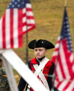 WATERTOWN, CT-121518JS05- Ryan Spring, 14, of Watertown, a member of the Brass City Young Marines decked in Revolutionary War uniform stands with fellow members of the young marines, during the annual Wreaths Across America ceremony held Saturday at the Old Burying Ground in Watertown. The event was hosted by the Trumbull-Porter Chapter of the Daughters of the American Revolution and the Waterbury Veterans Memorial Committee. Jim Shannon Republican American