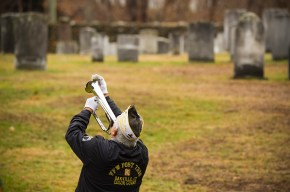 WATERTOWN, CT-121518JS09- Joe Ostroski, of Waterbury, a Vietnam veteran and past commander of VFW Post 7330 in Oakville, plays taps during the annual Wreaths Across America ceremony held Saturday at the Old Burying Ground in Watertown. The event was hosted by the Trumbull-Porter Chapter of the Daughters of the American Revolution and the Waterbury Veterans Memorial Committee. Ostroski served in the Navy on the USS Shangri-La (CV-38), an Essex-class aircraft carrier. Jim Shannon Republican American