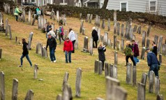 WATERTOWN, CT-121518JS11-Guests make their way thorough the Old Burying Ground in Watertown on Saturday during the annual Wreaths Across America ceremony. The event was hosted by the Trumbull-Porter Chapter of the Daughters of the American Revolution and the Waterbury Veterans Memorial Committee. Jim Shannon Republican American