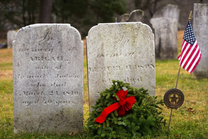 WATERTOWN, CT-121518JS13- A wreath and American flag was placed at the grave of a veteran during the annual Wreaths Across America ceremony held Saturday at the Old Burying Ground in Watertown. The event was hosted by the Trumbull-Porter Chapter of the Daughters of the American Revolution and the Waterbury Veterans Memorial Committee. Jim Shannon Republican American