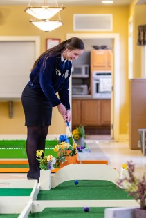 WOODBURY, CT. 15 February 2019-021519 - FFA student of Nonnewaug High School, Brenna Ritchie of Woodbury reacts after failing to hit her ball through the opening on one of the holes at the indoor mini-golf course at the Senior Center in Woodbury on Friday. Bill Shettle Republican-American