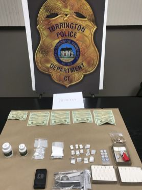 Cash, drugs and drug paraphernalia seized from an apartment at 39-41 Hoffman St. is shown in a photo taken by Torrington police. Contributed