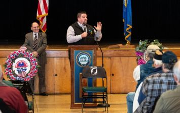 Keynote speaker Brian M. Ohler of Canaan, a combat veteran and three-time Purple Heart recipient, speaks about his experiences during the Torrington Veterans Support Committee's Gulf War Veterans Day Observance Thursday at Coe Park in Torrington. Jim Shannon Republican-American