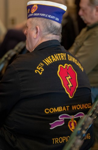 TORRINGTON, CT-022819JS06- A jacket warn by Purple Heart recipient Dan Eddinger of Torrington during the Torrington Veterans Support Committee's Gulf War Veterans Day Observance Thursday at Coe Park in Torrington. Officials, guests, veterans and current military personnel were on hand to honor veterans of the Gulf War and the War on Terror. Eddinger is the State Commander of the Military Order of the Purple Heart. Jim Shannon Republican American