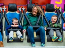 """WATERTOWN, CT-043019JS10-Melissa Calker of Watertown, center, rides the """"Avalanche"""" with Cole Adams, 4, left, and Zachary Corcoran, 5, both of Watertown, at the opening night of the annual St. Mary Magdalen School's carnival held Tuesday at the school in Watertown. The carnival runs every day through Saturday, May 4, 2019. Jim Shannon Republican American"""