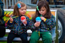 WATERTOWN, CT-043019JS11- Liz Lipeika, 4, of Morris left, looks over as she and her sister, Lyla Lipeika, 4, enjoys their sno-kone during the opening night of the annual St. Mary Magdalen School's carnival held Tuesday at the school in Watertown. The carnival runs every day through Saturday, May 4, 2019. Jim Shannon Republican American