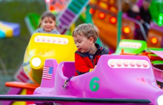 WATERTOWN, CT-043019JS12- Camden Correia, 5, of Watertown, looks down as the plane ride lights higher during at the opening night of the annual St. Mary Magdalen School's carnival held Tuesday at the school in Watertown. The carnival runs every day through Saturday, May 4, 2019. Jim Shannon Republican American