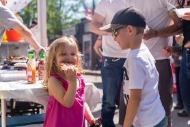 NAUGATUCK, CT. 18 May 2019-051819 - Keagan Ewings, 6, of Naugatuck, right, watches Sophia Wilcox, 4, of Norwich chow down on some pizza, during the annual Ion Bank/Naugatuck Spring Festival on Church Street in Naugatuck on Saturday. Bill Shettle Republican-American