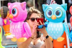 NAUGATUCK, CT. 18 May 2019-051819 - WHO's that. Jennifer Lopez of NYC, takes a selfie among the inflatable owls, during the annual Ion Bank/Naugatuck Spring Festival on Church Street in Naugatuck on Saturday. Bill Shettle Republican-American