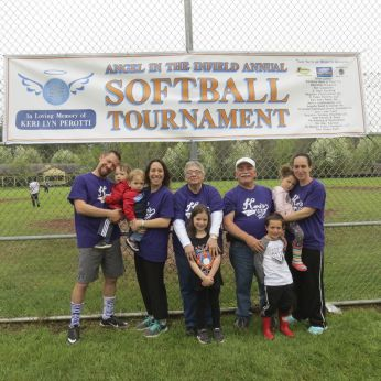 The family of the late Keri Perotti takes part in 'Angel in the Infield,' an annual softball tournament in her memory that was held Saturday in Canaan. From left are David Mlodzinski, her brother-in-law, holding Eric; her sister, Shannon Mlodzinski, holding Owen; her mother, Bonnie Perotti; her father, First Selectman Charles P. Perotti; and her sister, Marci Perotti, holding Kaelyn. In front are Ashlyn Mlodzinski and CJ Sanders. Ruth Epstein Republican-American
