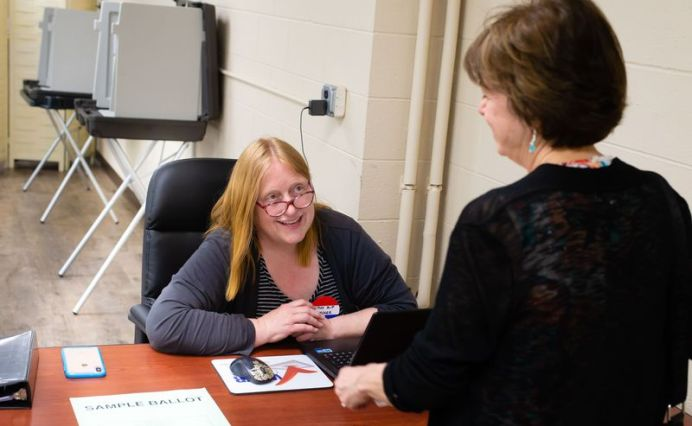 Cathy Russell-Patnaude, left, checks in Bethlehem resident Mary Ann Fotaine as she prepares to cast her ballot on the Region 14 school budget Tuesday at Bethlehem Town Hall. Jim Shannon Republican-American