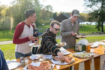 People pick from the many varieties of pizza during the Greater Waterbury Campership Fund's Big Green Truck party at Camp Mataucha in Watertown on Thursday. Bill Shettle Republican-American