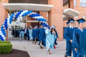 Oxford High School graduates walk into the football stadium before the commencement ceremonies at Oxford High School on June 11, 2019. Bill Shettle/Republican-American