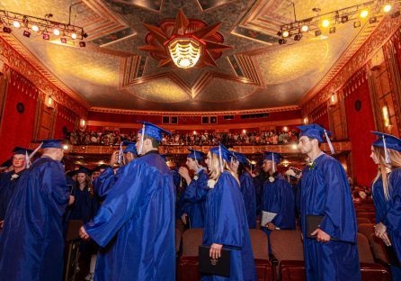 Oliver Wolcott Technical School graduates make their way out of the Warner Theater in Torrington at the end of graduation ceremonies on Wednesday. Jim Shannon/Republican American