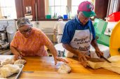 WATERBURY, CT. 12 July 2019-071219 - Dora Nave, left, rolls the dough as Ignazio Petraroia cuts it to size, as they prepare the dough to be sold as fried dough, during the second night of the 81st annual Italian Feast of Our Lady of Mount Carmel at Our Lady at Mount Carmel in Waterbury on Friday. Bill Shettle Republican-American