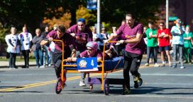 The team from Post University makes its way down Grand Street during the third annual United Way of Greater Waterbury's Bed Races held in downtown Waterbury on Saturday. The event is a fundraiser for the United Way. Jim Shannon Republican-American