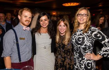 Brian Kimmey with the Palace Theater, left, with Worx employees, Nadia Baz: Kristen Doverspike and Marysia Walker, at the Main Street Waterbury's Annual Community Partnership Award ceremony held at the Palace Theater in Waterbury. Jim Shannon Republican-American