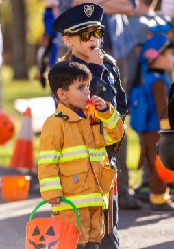 SOUTHBURY, CT. 26 October 2019-102619BS374 - Fireman Henry Shah, 3, left, and his sister Officer Lucy, 6, both of Southbury blow their whistles together in unison, during the ninth Annual Trick-or-Treat Spooktacular at the Southbury Center Firehouse on Saturday. The firehouse was transformed into a maze of different themed-rooms where kids could collect treats. Bill Shettle Republican-American