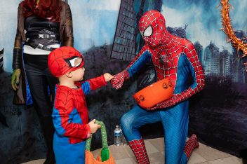 SOUTHBURY, CT. 26 October 2019-102619BS384 - Spiderman Joel Finch, 3, of Oxford, left, fists pumps another spiderman Jackson Masi, of Southbury in the Marvel Heroes themed room, during the ninth Annual Trick-or-Treat Spooktacular at the Southbury Center Firehouse on Saturday. The firehouse was transformed into a maze of different themed-rooms where kids could collect treats. Bill Shettle Republican-American