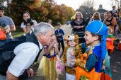 """SOUTHBURY, CT. 26 October 2019-102619BS394 - Bill """"the magician"""" Hoagland of Milford, left, asks Matteo Viscuso, 7, of Orange to hold his hands tight for a magic trick, during the ninth Annual Trick-or-Treat Spooktacular at the Southbury Center Firehouse on Saturday. The firehouse was transformed into a maze of different themed-rooms where kids could collect treats. Bill Shettle Republican-American"""