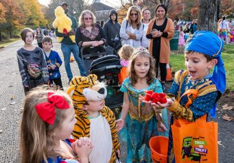 SOUTHBURY, CT. 26 October 2019-102619BS395 - Matteo Viscuso, 7, of Orange, right, reacts after opening up his hands with many items from a magic trick as, from left, his sister Olivia, 5, and his cousins Nico LaRoche, 4, and Stella LaRoche, 6, both of Southbury look on, during the ninth Annual Trick-or-Treat Spooktacular at the Southbury Center Firehouse on Saturday. The firehouse was transformed into a maze of different themed-rooms where kids could collect treats. Bill Shettle Republican-American