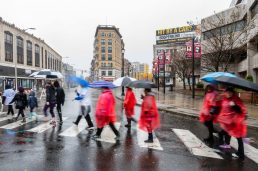 WATERBURY, CT. 27 October 2019-102719BS704 - Walkers cross South Main Street and Bank Street in downtown Waterbury in the pouring rain, during the eleventh annual walk and race fundraiser for the St. Vincent DePaul Mission of Waterbury on Sunday. The Walk took the participants through the St. Vincent DePaul Mission's Thrift Store, Soup Kitchen, and Shelter, the same facilities where the poor receive clothing, food, and a place to sleep, with the guidance of Mission staff. Bill Shettle Republican-American